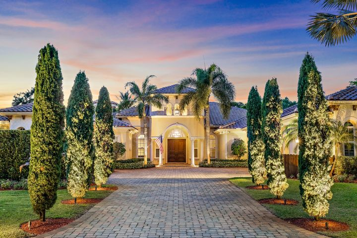 Custom Estate fully automated smart home. Over an acre of land & no HOA in downtown PBG. Moments from water, shopping & all that NPB offers. Outdoor entertainment is easy. Transition from inside to out when you push back the glass Plaza doors that open up to a great entertainment area. Featuring a wood burning fireplace, large outdoor living area, extra large summer kitchen, outdoor theatre, pool & spa, impact windows & protective armor screens. Chef's kitchen has custom cabinetry, walk in pantry, 10 foot island that over looks the large family room which doubles into it's own personal theatre. Custom millwork & closets, steam room, 2 indoor fireplaces, temperature controlled private wine room add to the special features this home has to offer. Guest house w private entrance & generator.