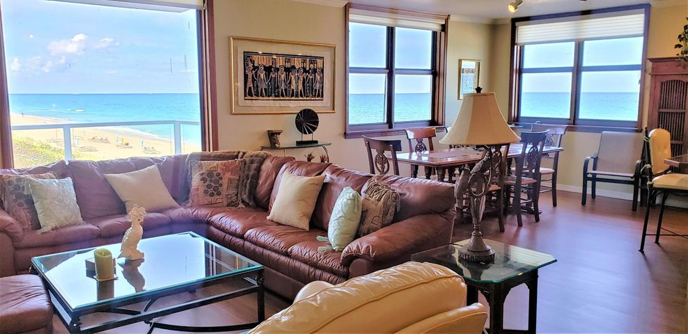 DRASTICALLY REDUCED!!! This 2 bedroom 2 bath floor plan has been completely gutted and altered  so now you have an open living space that focuses on the ocean. Cook until your heart's content and enjoy the views, or entertain guests without having to go outside for more room. Wood floors and vinyl plank wood floors warm the main living area, high end impact hurricane windows throughout, plantation shutters for privacy and double door entrance into the master suite. The small, den/office is currently used as a 2nd bedroom, but it does not have a window or closet. The 2nd Bathroom offers a Jacuzzi tub and is across the hallway. The utility closet has plenty of room to add stack-able W/D, if desired.  The Patrician is undergoing concrete restoration and numerous other improvements,  but don't be afraid of this apt, the Seller has paid the assessment in full!!!  This full amenity building offers you the best of everything. Don't wait too long or this apt will be gone. The amenities include 24 hr. door person, garage and open parking, new lobby, heated pool, built-in BBQ, private locked, deeded beach access, social room, exercise room, library, full time manager, maintenance staff and more.