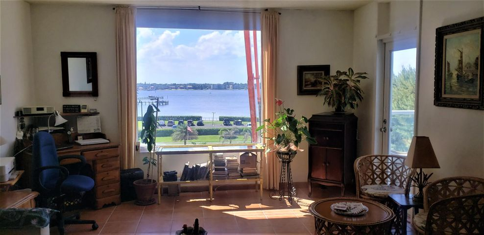 This updated 1 bedroom 1 bath unit offers direct Intracoastal views from the fourth floor. Tiled floors throughout, updated kitchen and bath with 1 covered parking space, hurricane impact windows throughout. The Patrician has levied an 11 Million dollar special assessment for concrete restoration and other much needed improvements. A list of these items will be under documents for your review. The Seller has paid the assessment in full. The glass front balconies will enhance and modernize the building. The Patrician is a full amenity oceanfront building with 24-hr door person, Pool & BBQ on the oceanfront deck, updated fitness center, club room and more! Own your own piece of paradise and live like you're on vacation year round! The low maintenance of just under $600 includes 24-hr doorman, and security, Basic Cable, Wi-Fi, Water, Hot Water, Garbage, Pest Control, AC portion of electric bill, common laundry, heated pool, built-in BBQ, Social Room, Fitness Room, Garage and Open Parking, Storage, and Manager on site,