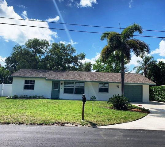 Charming 3 bedroom, 2 bath home with a 1 car garage is in the heart of Palm Beach Gardens.  The home is in excellent condition - newly painted inside and out, brand new carpeting in bedrooms, completely remodeled baths.  Nice large patio and yard.  Inside laundry room and plenty of storage.