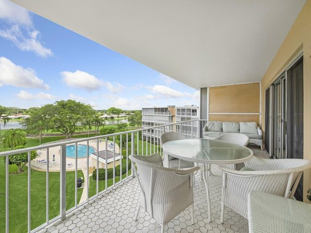 open balcony with expansive views of the golf course and lake beyond