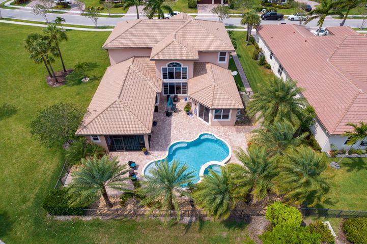 AERIAL VIEW, INCLUSIVE OF THE HOME, LANAI, RESORT POOL, AND DECK