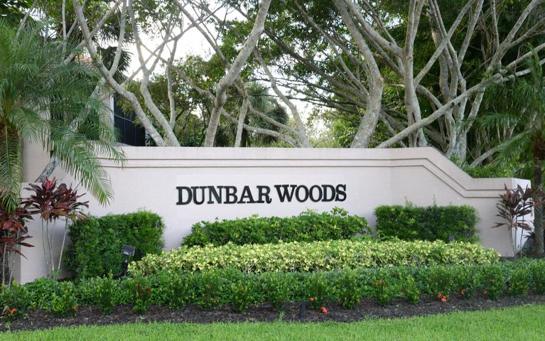 THIS CONDO INSIDE PICTURESQUE DUNBAR WOODS AT PGA NATIONAL