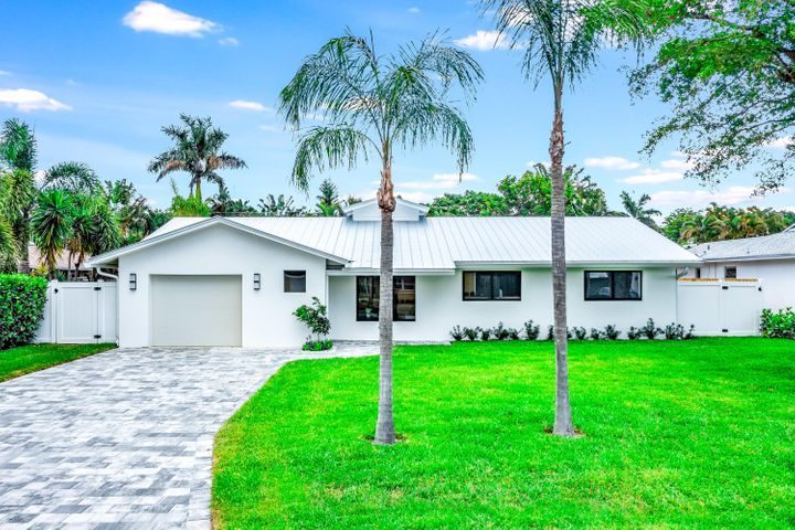 Remarkably Renovated, South Florida Style Home !
