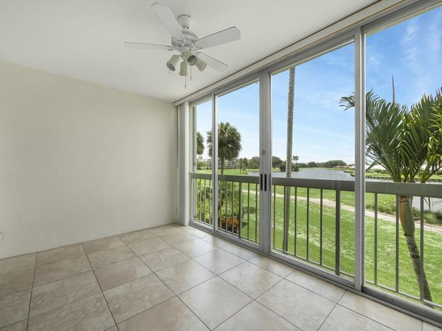 Serene open lake and golf views from tile morning room