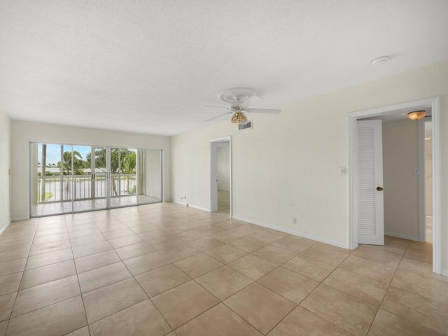 Living room has tile flooring, opening to morning room