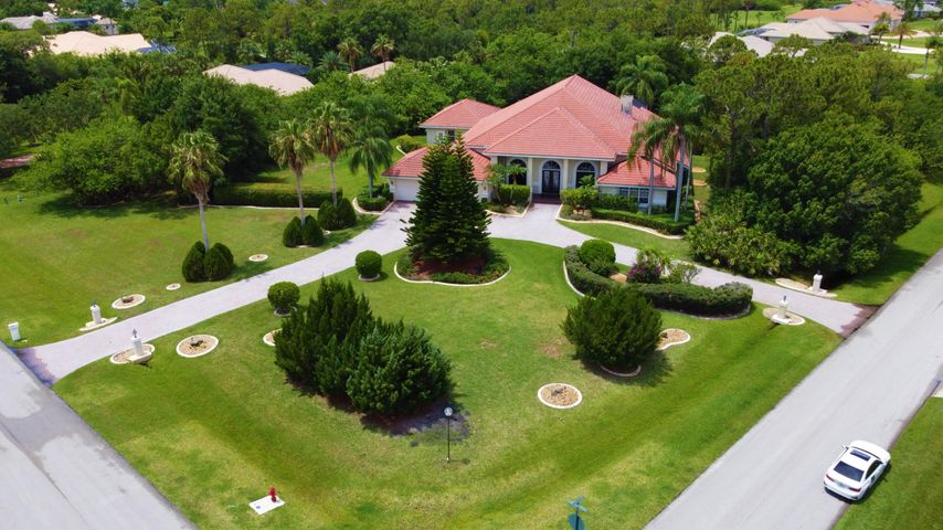 Gorgeous Home with Lush Landscaping on a approximately 1.75 acre Corner Lot.