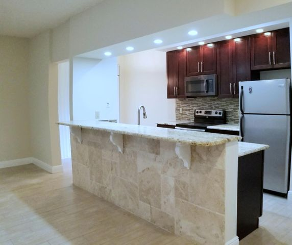 Totally remodeled kitchen, granite counters & extended bar, with stainless appliances