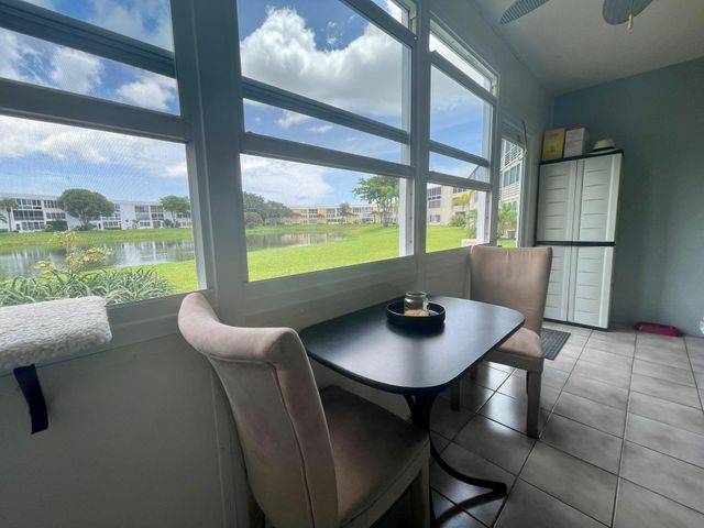 Lovely Ground Floor Wellington Condo With Water Views & Updated Enclosed Lanai