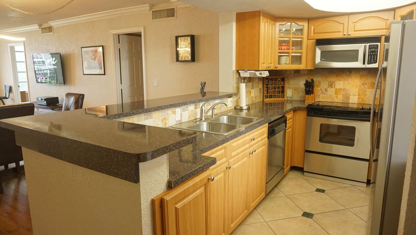 Enter and enjoy the kitchen and view to living area.