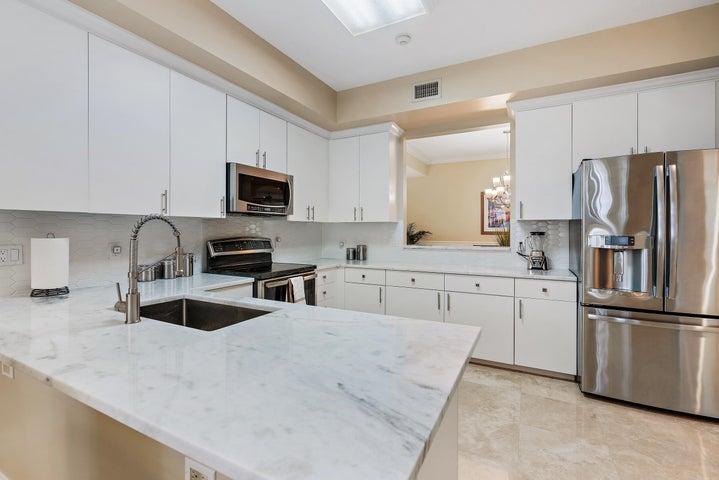 Gorgeous white kitchen with quartz countertops