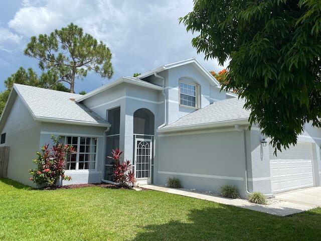 145 Heatherwood Drive, Royal Palm Beach, FL 33411