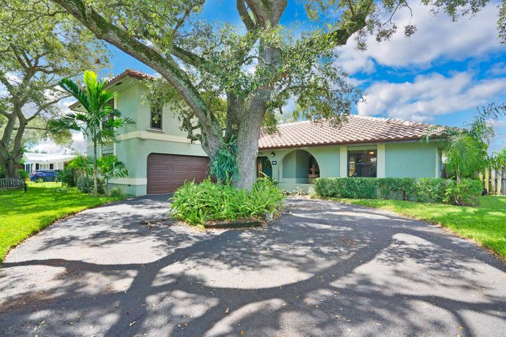 Dramatic mature oaks and a gated drive provide great privacy!