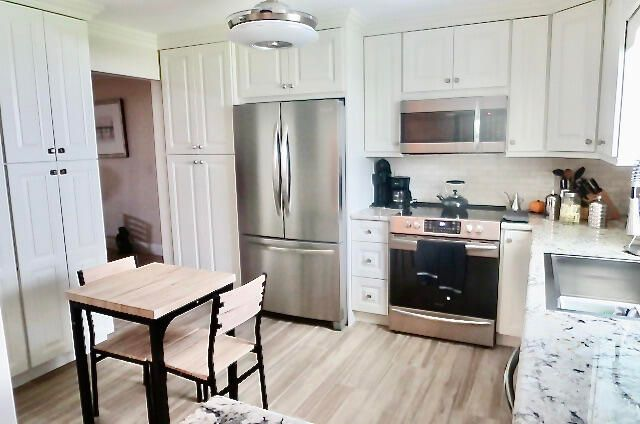 Recently renovated - granite, S/S appliances, floor to ceiling cabinets/pantry, new fan, new plumbing and electrical