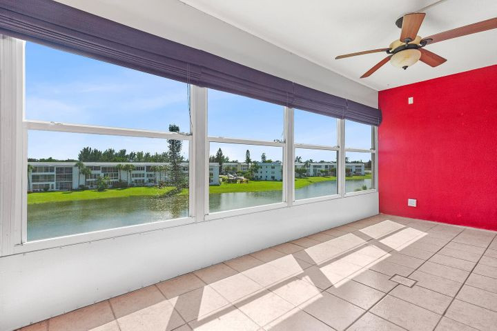 Spacious, Bright, And Beautiful In The Desirable Wellington Area Of Century Village! Enjoy lovely water views from the large enclosed lanai!