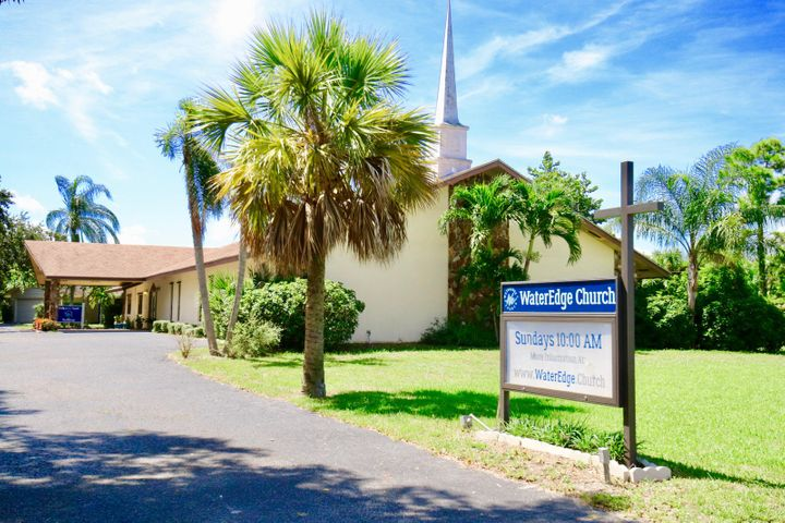 Beautiful church being sold in conjunction with two other parcels. Together there are a total of four buildings on 3.25 acres. Total square footage under air equals around 12,000 sq ft. The other two parcels contain a triplex and a single family home. All three parcels are zoned multi-family and are located in unincorporated Palm Beach County. Currently collecting $4,150 in rent from other churches for non peak time slots.