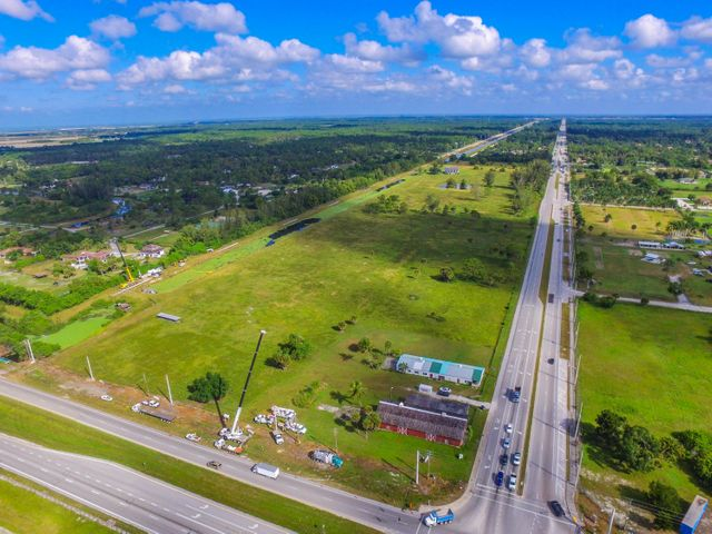 Amazing opportunity for a commercial developer on this NW corner of Southern Blvd and Seminole Pratt Rd. 64.5 acre property.  Currently zoned low density commercial.  Southern Blvd. is THE major artery connecting West Palm Beach to Belle Glade and Western Florida. Great location for Racetrac, Wawa, 7-Eleven, Tutor Time or Learning Experience Child Care Facility, Big Box Store, this is the last stop for cars going west when leaving West Palm Beach. Westlake residential development to the north and Arden development to the immediate west. Traffic volume at this intersection taken on 1/13/16 was 21,367 with project growth of 2.67%.  Property is subdividable. With proper permits.