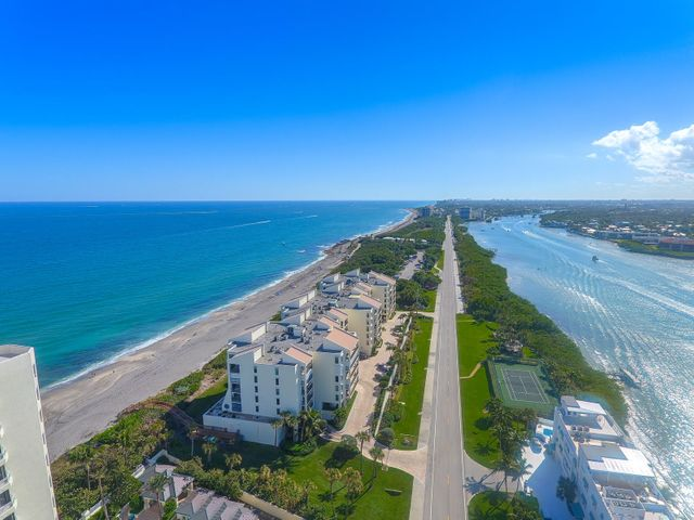 Enjoy both intracoastal and ocean views from this stunning direct oceanfront condo located on Jupiter Island. This 2-bedroom, 2-1/2 bath unit offers extraordinary turquoise ocean and intracoastal views from every room. Light and bright with open floorplan. Renovated kitchen with granite countertops and backsplash, stainless steel appliances, including a wine refrigerator. Crown molding, plantation shutters, new lighting fixtures, and ceiling fans. Dining area opens to living room with ocean side large balcony to enjoy a peaceful sunrise and spectacular ocean views. Travertine floors in living areas. Large guest bedroom with private bath and balcony with views of the intracoastal. See additional write-up... Spacious master suite features walk-in closet, separate dressing area with built in drawers, renovated bath with his and her shower, and balcony overlooking the intracoastal, perfect for spectacular sunset and lighthouse views.   Seawatch offers first class amenities that include: 24 hour manned security, exercise room, large game room, separate party room with kitchen, two boardwalks to the beautiful beach, kayak, paddle board and bike storage, large private storage area on unit floor, 2 indoor gated garage parking spaces, heated pool, whirlpool spa and sun patio are on the ocean side and tennis courts, pavilion and day dock are on the intracoastal side. Exterior of building was recently refinished and painted.  One pet less than 25 pounds is permitted. Rental restrictions apply, see broker remarks.