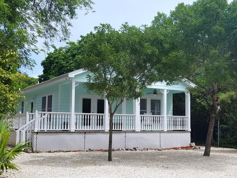 Key West style home with no neighbors on either side.  Good size 3/2 home with covered front porch and wrap around deck. Large rooms, bamboo floors, high ceilings, crown molding, custom closet shelving, metal roof, impact resistant windows, separate laundry room. Easy to show.