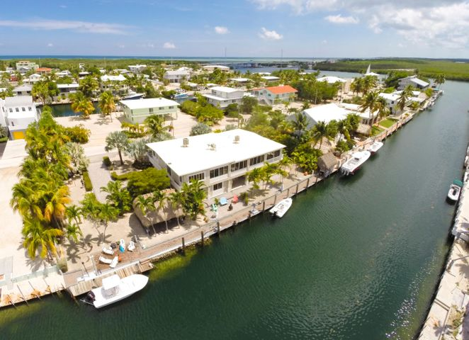 Magnificent home with elevator, garage, workshop and 170ft. of dockage only minutes to bay or ocean!