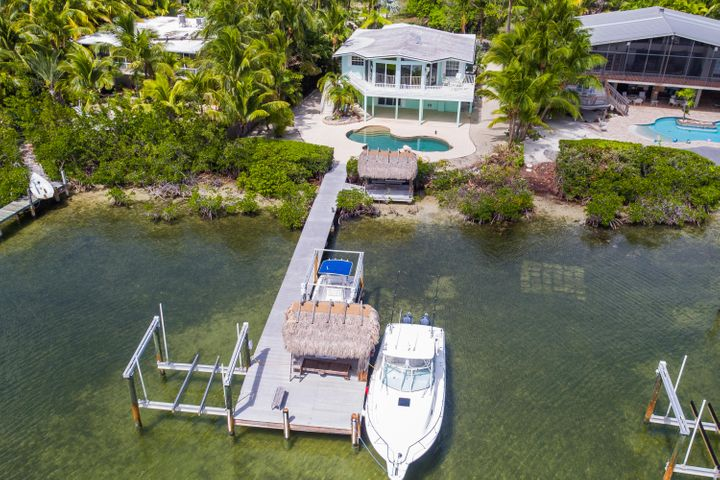 Bayfront home with lots of dockage, 2 boatlifts and a pool!