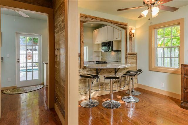 Restored Wood Floors and Walls. Breakfast bar added with french doors leading to swimming pool.