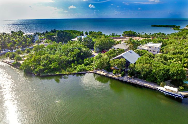 Exceptional Islamorada Home in gated Plantation Lake Estates with over 120 ft of Dockage on Double Lot