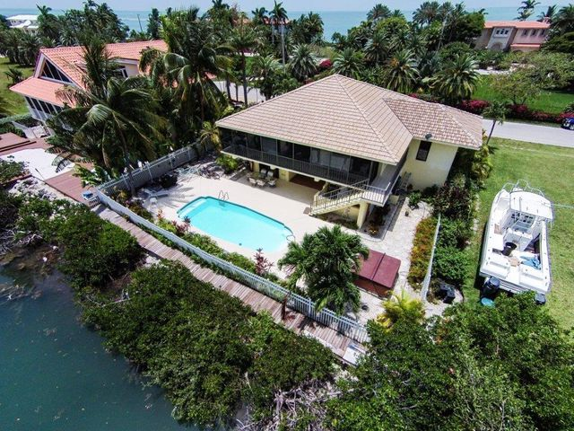 Aerial views shows back of home and all the privacy it has to offer.