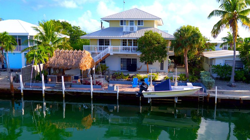 4 Bedrooms, 3 baths, dockside chickee, 70 ft. of concrete dock and 15,000 lb. lift