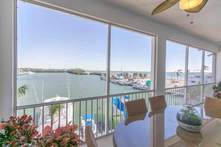 Captain's Cove & Ocean Views from this top floor end unit in Bay Harbour!