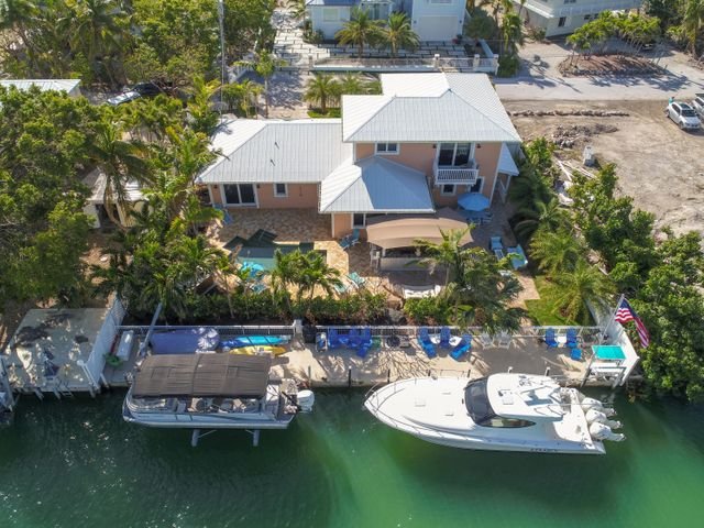 95 ft. of dockage, 20,000 lb. boatlift, pool, summer kitchen, 4 bedrooms and 4.5 baths, updated in 2009, one lot in from Tavernier Creek with no bridges to the ocean!