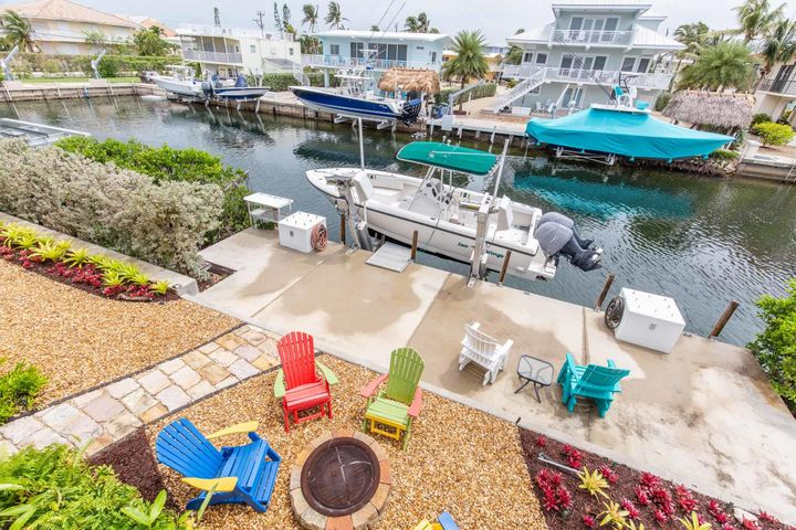 65 ft. of canal front and a 15,000 lb. boat lift