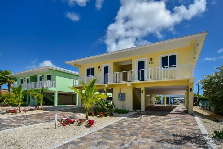 40 & 410 3rd Street Key Colony Beach full duplex rental income property with annual leases in place.