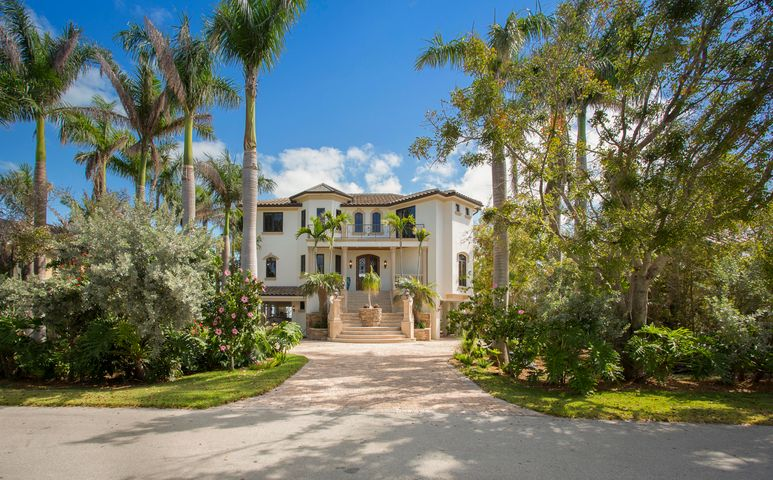 Peaceful surroundings, grand sunrises and tranquility abound in this magnificent ''Signature Estate'' on the Gulf of Mexico. Located in the private, gated Community of Shark Key, this 4 bedroom, 5 bathroom, Office & theater room home sits 14,850 Sq. Ft. of paradise.