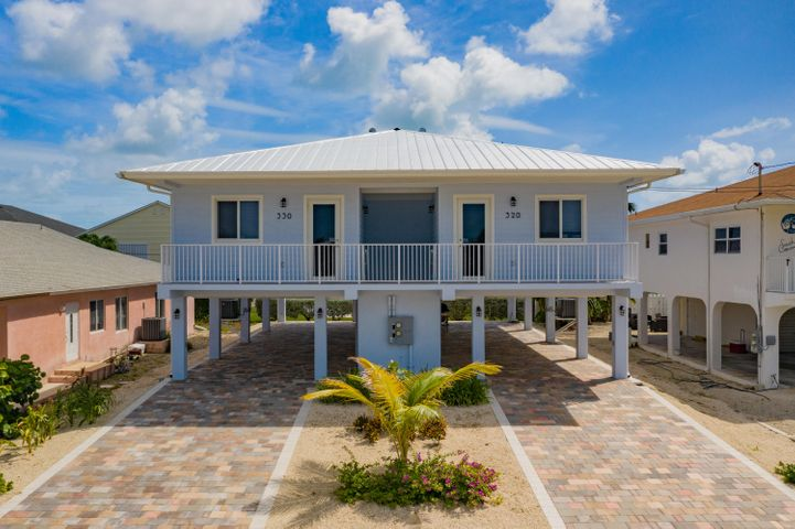 Colony Beach full duplex rental income property with annual leases in place.