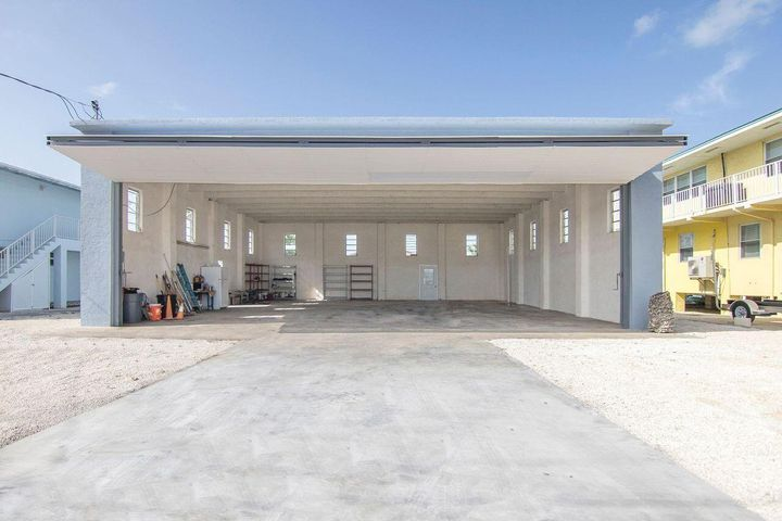 This Hangar fits two good size Airplane.