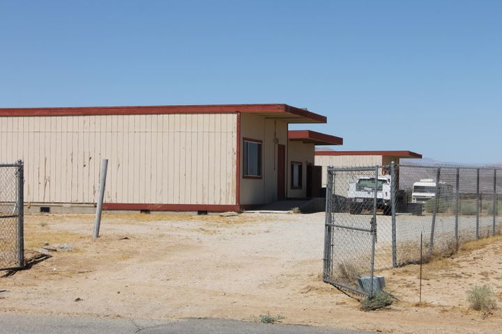 Three 940 sq ft buildings on 1.1 acres zoned Industrial