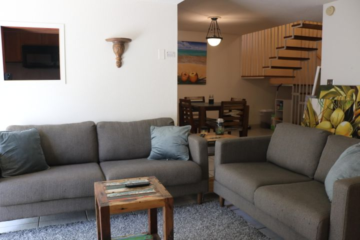 Sofa, love seat, carpet, and coffee table included