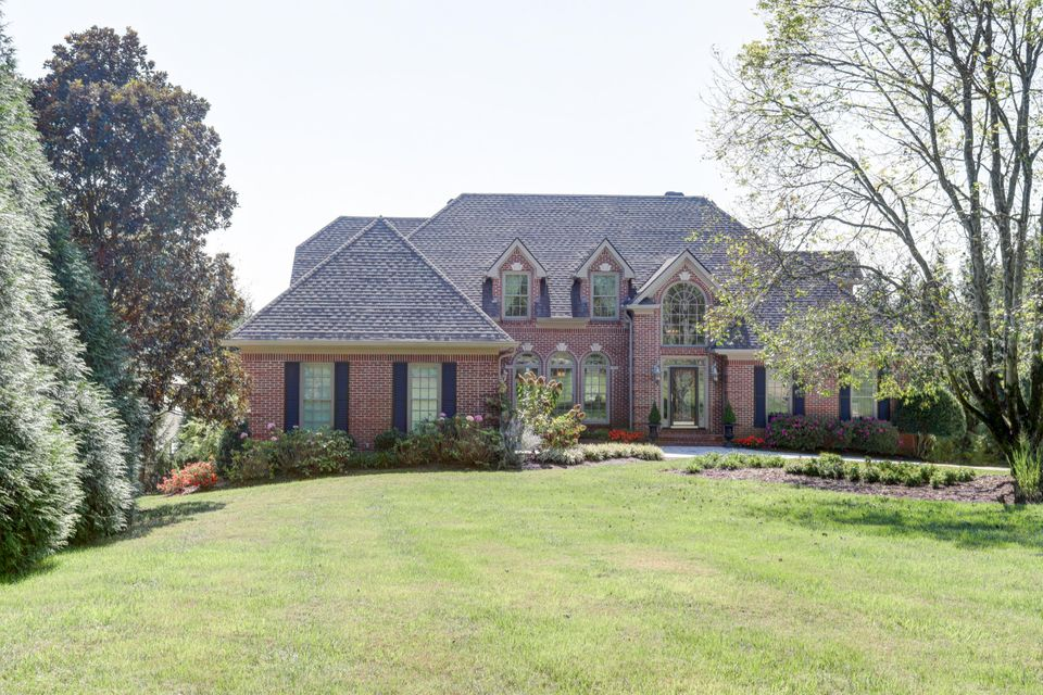 A rare find: All brick lakefront home, level 1 acre lot, quiet one street subdivision. In-ground pool, boat house with double covered boat slips, includes jet ski lifts , dock launching ramp, sea wall. Pristine condition. 4 car garage, master suite on main level, cathedral ceilings, 3 fireplaces, keeping room, exercise room, study, bonus room, 5th bedroom (poolside level) accesses 4th full bath and second (pool level) kitchen . Lots of windows and natural light, hardwood floors and staircase, solid surface counter tops, stainless steel appliances(includes viking professional series)wall oven and gas cook top, ice maker refrigerators, dishwashers, covered (pool side) patios. Too many features to mention. Must see to appreciate. The perfect lake home for family, guest and entertaining. 1.5 miles to grocery store, approximately 5 miles to restaurants and charming Ooltewah community.  Approximately 5 miles to I-75, and 2 miles to Hwy 58 and less than 15 miles to airport.