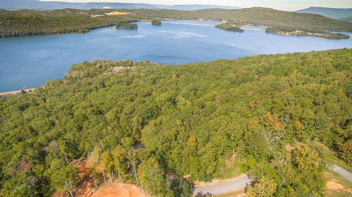 Close to US Hwy 72, Interstate 24, and to the Port Authority. Near Graham Cove off of Hwy 156, Shellmound Rd. Beautiful 5.1 acre property across from Nick-A-Jack Lake in Nick-A-Jack Landing. Buyer Bonus: If buyer purchases this lot & the next door Parcel ID/Tax ID 145  082.00 together, purchase price is to be $60,000 total for both.