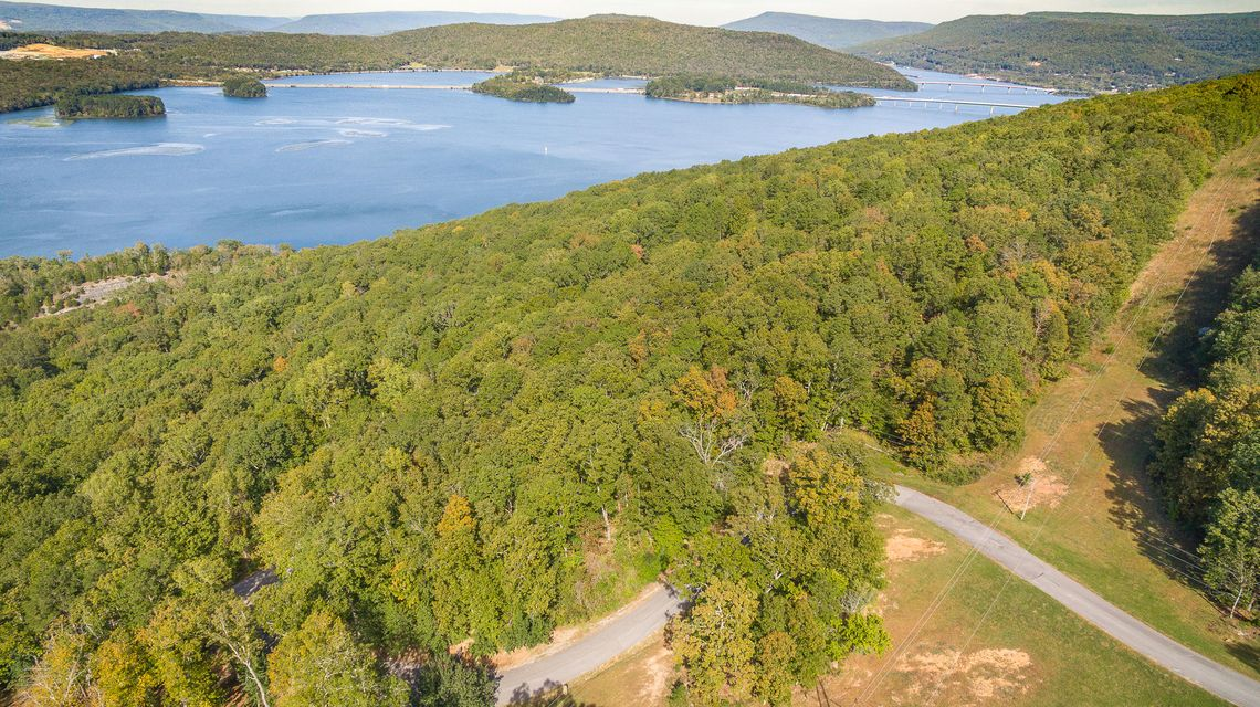 Close to US Hwy 72, Interstate 24, and to the Port Authority. Near Graham Cove off of Hwy 156, Shellmound Rd. Beautiful 5.1 acre property across from Nick-A-Jack Lake in Nick-A-Jack Landing. Buyer Bonus: If buyer purchases this lot & the next door Parcel ID/Tax ID 145  083.00 together, purchase price is to be $60,000 total for both.