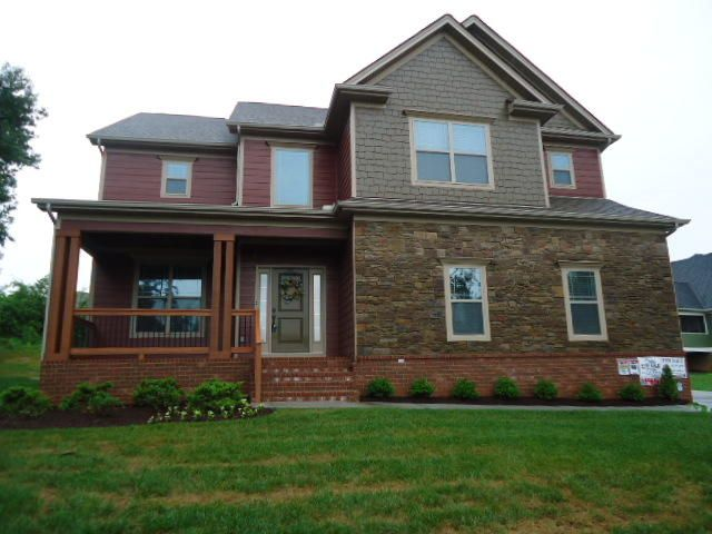 WELCOME HOME to McKenzie Farms! This beautiful home is located next to the Ooltewah Elementary School. Our craftsman style home features 4 bedrooms and 2.5 baths WITH BRAND NEW CARPET and INTERIOR has JUST BEEN PAINTED. This maintenance free home has a combination of brick, board and batten Hardie board, shakes and stone. The great room features a soaring ceiling, open design and cozy gas log fireplace with handcrafted mantel. The gourmet kitchen features granite counter tops, travertine tile back splash, custom cabinetry, and stainless steel appliances including microwave, dishwasher, free standing electric range and refrigerator. The master suite features a double trey ceiling, walk-in closet, recessed and decorative lighting, double bowl vanity, tiled shower and jetted tub. All of of the spacious bedrooms and laundry room are located upstairs. This home has a 2-car garage, screened porch, open deck and SO MUCH MORE! This home is conveniently located with easy access to I-75 and I-24, only minutes to downtown, airport, shopping and hospitals. This craftsman style designed home offers comfort and luxury. Call TODAY! (PLEASE NOTE: THE SELLER IS AN OWNER/AGENT)
