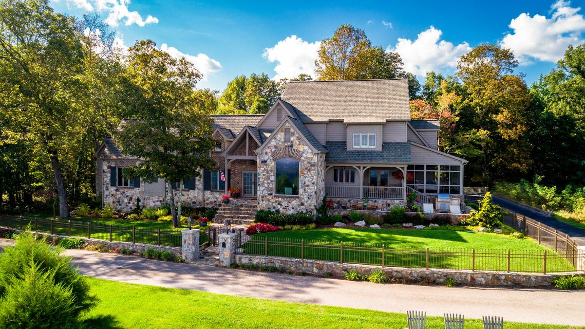 Stately Brow Home with unparalleled views, impeccable curb appeal and upscale finishes situated on a private lot is now available.  From the moment you pull into the quiet drive at 3403 E Brow, you know you have arrived at a special residence.  The current owners have spared no expense or omitted any upgrade as they transformed their home into one of the most beautiful, yet livable residences on Signal Mountain.  The outdoor living environments are  second to none thanks to  the screened porch, stone patio and fenced yard, the entire valley is your front lawn.  The back yard is extremely private and can be enjoyed from a covered porch, patio or expansive pool environment. The artfully designed landscaping ensures your complete privacy. When you step inside you are greeted by soaring ceilings, filled with natural light and lushly appointed finishes.  The Kitchen is open to the keeping room and dining area, so it will be the gathering spot for friends and family to enjoy.  The Master Suite  occupies the south wing of the residence and is a true retreat.  The upper level features numerous bedrooms, all with new bathrooms and casual gathering areas.  The lower level offers a perfect teen or inlaw suite with numerous access points to enjoy the patio and pool environment.    There is no limit to storage thanks to a 3 car garage and walk out storage on the lower level.  The listing agent can provide a complete list of the updates and upgrades current owners have made.  Schedule your private tour today!SPECIAL FINANCING AVAILABLE ON THIS HOME COULD SAVE YOU $14460.