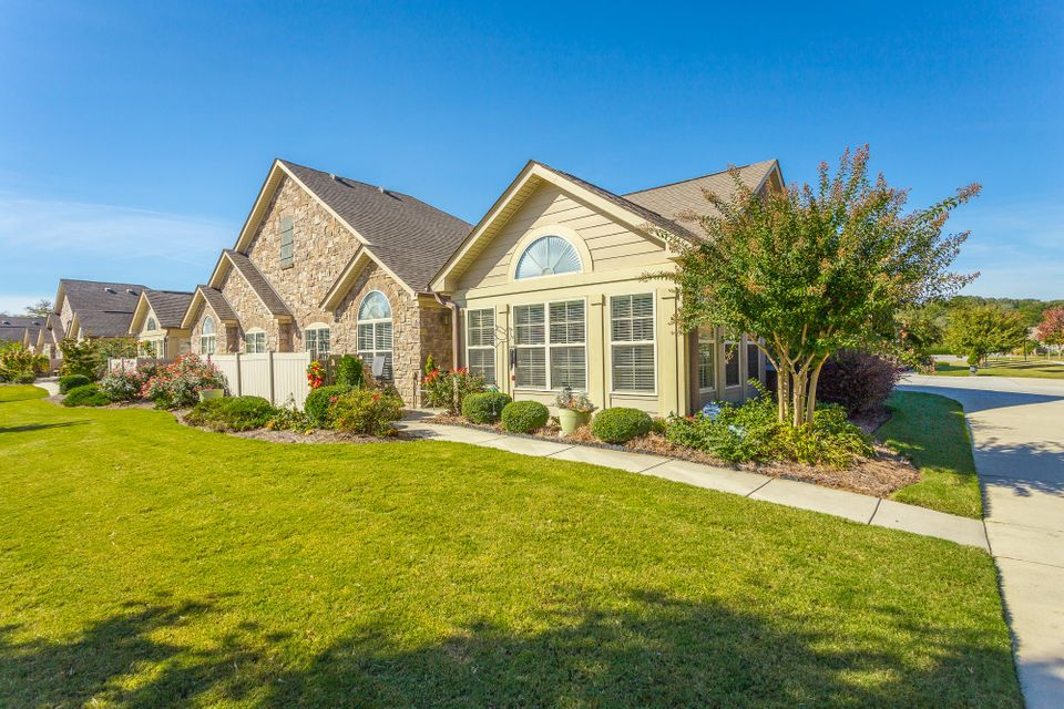 Welcome home to Stonebrook Condominiums in Ooltewah where you have walking trails, sidewalks, community ponds, a clubhouse with pool and all very convenient to shopping and local restaurants!  This 2 BR, 2 BA plus office and sunroom is perfect for those seeking easy one-level living. It has great curb appeal on its corner lot, 2 car garage, private front porch courtyard, beautiful hardwood flooring and an open floor plan. The monthly HOA fee pays for your exterior building home insurance, all yard maintenance including irrigation, interior water supply, termite coverage, garbage service, and maintenance of the common grounds of Stonebrook including the clubhouse and pool.  Make your appointment today before it gets away!