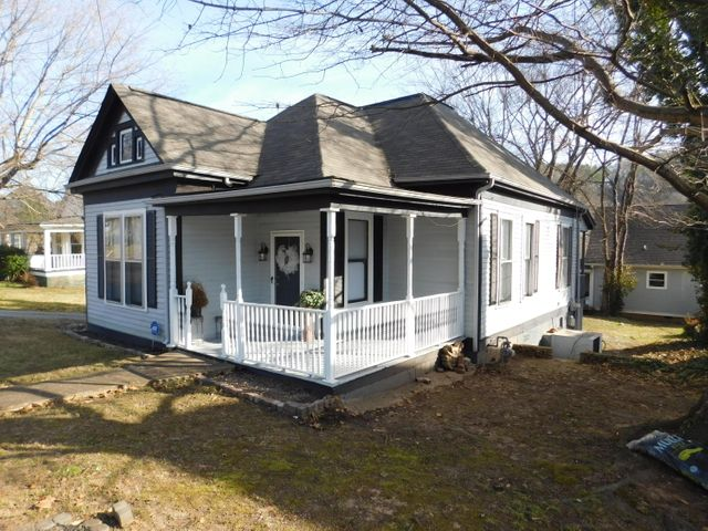 Historic Home at 4518 St Elmo Ave with large sitting porch