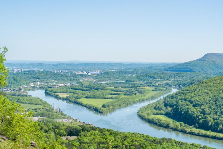 Defining the Scenic City and the meaning of Location, Location, Location is 10 Close Family Road. Calling home the front of Signal Mountain's desirable Old Town while overlooking the Tennessee River, Lookout Mountain and Williams Island where endless views of the river gorge are a state of mind & convenience to everything downtown Chattanooga is constant. Surrounded by spectacular water & mountain day vistas allowing you to see forever while capturing sparkling city lights of downtown Chattanooga at night. This full brick and stone custom checks all the boxes in home ownership. Located at the end of a quiet cul-de-sac & thoughtfully designed and built to capture majestic views both inside and out! Multiple outdoor areas flow seamlessly from outside into the spacious, open living areas of the interior as one. Surrounded by panoramic views from all rooms, even from the laundry room, everyday life feels like a weekend escape! From covered entry, a casual tone relaxes and reinforces the comfort of home. The main foyer opens to a two story family room filled with natural light and panoramic views with floor to ceiling stack stone fireplace promoting a warm comfort of home. Kitchen was designed so the cook is never isolated from the family fun flanked by the oversized family room and morning room. Billiard room and study with fireplace are flanked by built-ins overlooking the Tennessee River Gorge. Main level master is privately tucked away on the opposite wing from the living area for maximum quiet and relaxation. Separate vanities, his & hers closets invite peaceful mornings. Three bedroom suites with walk-in closets and full baths open to outdoor sitting areas and magnificent views. With four garages, car storage and workshop space abound. Located atop Signal Mountain which was voted America's number one small town to raise a family, this home offers something for everyone . . . great schools & convenience. Only minutes from the heart of downtown Chattanooga, the North Shore and Southside where top tier dining, shopping and recreation await you from this masterfully crafted home and impeccably maintained grounds.