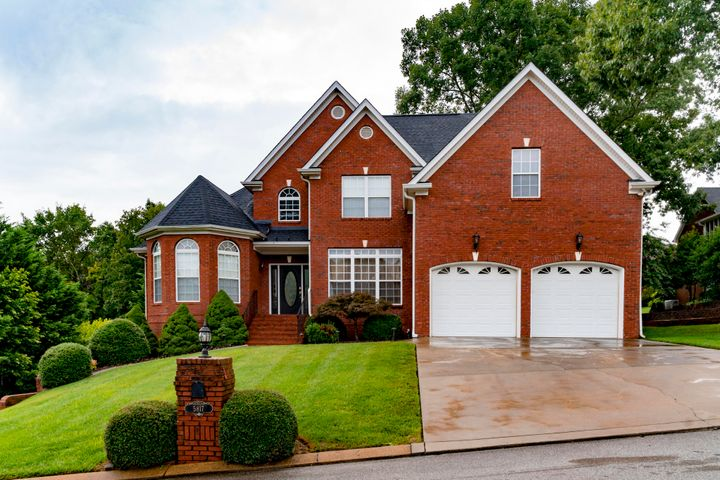 "BUY OR LEASE!!  Welcome to 5817 Players Court in the community of Eagle Bluff. Warm brick, traditional design, over 4500 square feet of well designed living space, a park-like fenced back yard with its own koi pond, covered and open living space and a ''Joanna Gaines'' worthy rustic-chic spa bath make this 3 bedroom/3.5 bath home something very special. An ideal family home and retreat, it meets every need with formal dining room, open kitchen with casual dining area and a full  fiished basement/lower level with entertaining kitchen/wet bar and fitness room. Outside the handsome iron fence surrounds the gently rolling back yard with mature trees and landscaping.  A zen corner has sheltering trees and a rocked koi pond. Back inside, the generous master on the main level has a new ""must see"" rustic chic spa-like bathroom retreat. Featuring a sliding ""barn door"" and custom cabinetry with wonderful craftsman detail. Beautiful tiled walls and a large open tiled spa shower with the light filtered by glass block tile plus multiple shower heads complete the luxury experience. Of note a new roof, 3rd garage bay in basement, irrigation system and the community assets of Eagle Bluff including clubhouse and community pool."