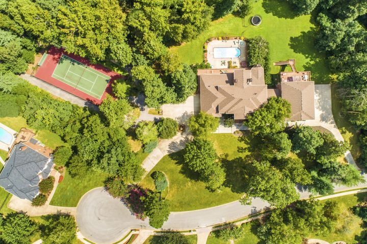 Why Is This Home Only $1,500,000??  That's What You'll Be Asking Yourself When You Visit 515 Gentlemens Ridge, Signal Mountain, TN!  Considering this Estate sits on 3.25 Private Acres, Complete with Tennis Courts, Track, Beautiful In-Ground Heated Pool, Entertainment Tiki-style Sports Bar and Outside Entertainment Area, in an Exclusive Subdivision with Like Styled Homes, in a Cul-de-Sac, with One of the Top Public School Systems in Tennessee, and Low County Taxes, This Home is a Bargain!  But Wait Until You See the Inside of Your New Home!  Where Do You Begin?  Would You Start with The Grand Entrance and Open Foyer with its 30' Ceilings, or the Winding Staircase, The Floor to Ceiling Windows Bringing In the Panels of Natural Light, or The Large Formal Dining Room, The Spacious, Library/Office, or The Huge Gourmet Kitchen with Highest End Stainless Appliances and Custom Finishes adjoining the Keeping Room?  Or, Would You Start with the Massive Master Suite with its Large Sitting Area, 1 or 7 Fireplaces, Closet's Galore, Huge Master Bath with Over-sized Shower, Soaking Tub, Double Vanities, and Laundry Room?  Maybe you'd Start Upstairs to Find 4 Additional Large Bedrooms, Each with Their Own Full Bath and Tons of Storage.  You Might Start on the Terrace Level, There's So Much to See Here, Too!  The Theater Room, The Full Kitchen Perfect for A Guest or Mother-in-Law Suite, with a Large Adjoining Den, Game/Pool Room, Full Bedroom and Full Bath with Huge Shower, The Workout Room, and Laundry Room.  Maybe You'd Skip the Main House and Start in the Adjoining Events Space. This Is Unbelievable!  On the Main Level is a Massive Garage Space Designed to Accommodate Up to 9 Vehicles in Addition to The 3 Car Garage in the Main House.  The 3 Garage Doors are 18' Tall to House Motor Homes, Vehicle Stacking  Systems; Large Boats, and More.  And, Once Inside, Walk-up the Staircase to the AMAZING Event Room Complete With Multi Audio Visual Setups, Sports Bar, Full Kitchen, Fireplace, Dance Floor, Laundry, 1 Full Bath and ½ Bath, Leading to a Full Outside Deck Space which Walks Down to the Wonderful Entertainment Area with Pool, Tiki/Sports Bar, and Level Lawn for More Play.  It Really Doesn't Matter Where You Start at 515 Gentlemens Ridge Because It All Ends At WOW with over 10,564 sq. ft of living space!   Why Is This Home Only $1,500,000?  Because the Sellers Have Priced This Amazing Home So They Can Begin Their Next Adventure, And Help The New Owners Experience All This Home and Community Has To Offer!