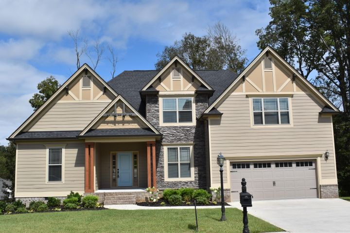 WELCOME home to McKenzie Farms! This beautiful home has just been completed painted on the inside and BRAND NEW CARPET.  This craftsman style home features 4 bedrooms, 2.5 baths with finished bonus room that can be used as a 5th bedroom or media room! This maintenance free home has a combination of brick, board and batten Hardie board, shakes and stone. The great room features a soaring ceiling, open design and cozy gas log fireplace with handcrafted mantel. The gourmet kitchen features granite , travertine tile back splash, custom cabinetry, and stainless steel appliances including microwave, dishwasher, free standing electric range and refrigerator. The master suite features a double trey ceiling, walk-in closet, recessed and decorative lighting, double bowl vanity, tiled shower and jetted tub. The additional bedrooms are located upstairs and designed for privacy and functionality. This home has a 2-car garage, screened porch, open deck and SO MUCH MORE! This home is conveniently located with easy access to I-75 and I-24, only minutes to downtown, airport, shopping and hospitals. This craftsman style designed home offers comfort and luxury. Call TODAY! (PLEASE NOTE: THE SELLER IS AN OWNER/AGENT)