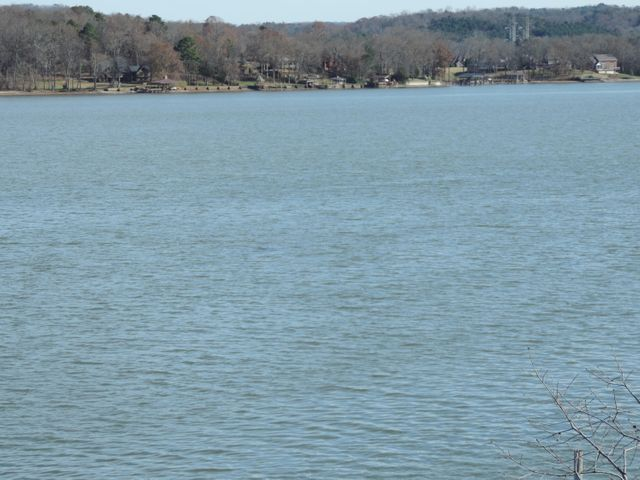 All brick located on the beautiful Lake Chickamauga portion of the Tennessee River. This property is complete with a floating dock, majestic panoramic and breathtaking views up and down river on year around water. With the disappearing opportunity for lake front ownership close-in to Chattanooga at a fair price this may be your calling.